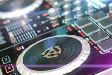 DJ turntable sound mixer in nightclub