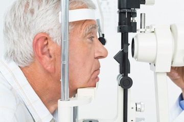 Senior man getting his cornea checked