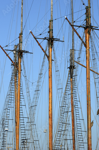 wooden sailboat mast on blue sky