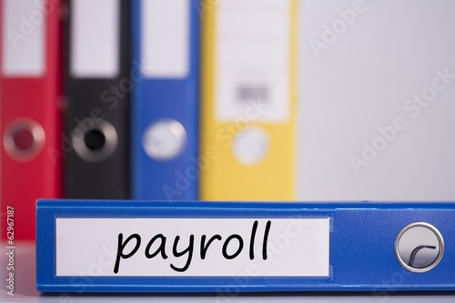 Payroll on blue business binder
