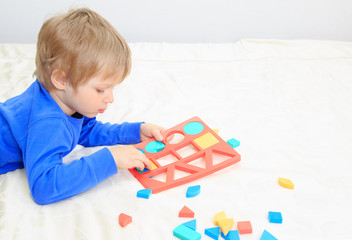little boy learning shapes