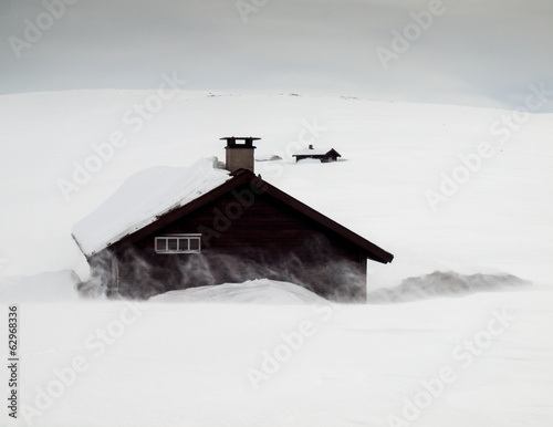 mountain huts in snow storm