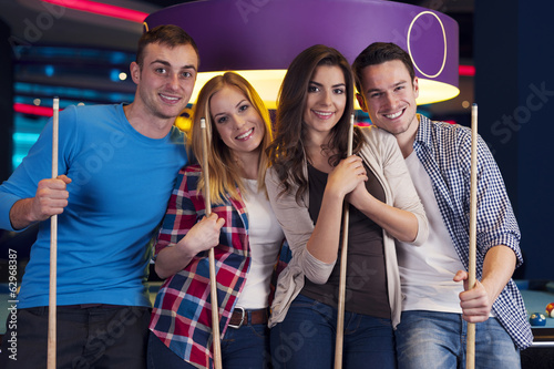 Portrait of group of friends on billiard