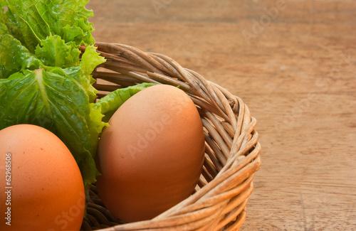 Eggs in a basket with lettuce