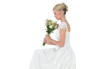 Bride holding flower bouquet over white background