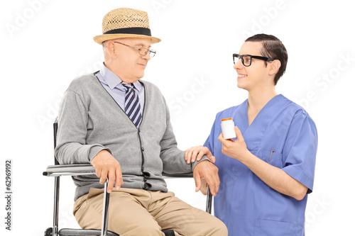 Male doctor giving medications to a senior man