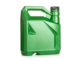 Green plastic canister of motor oil isolated on white background