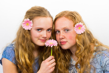 Two dutch girls with pink flowers in hair