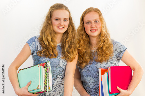 Dutch schoolgirls carrying textbooks