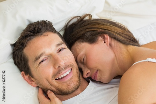 Close-up of a loving couple lying in bed