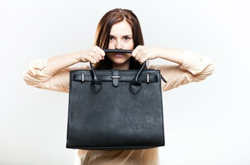Elegant young woman holding leather bag