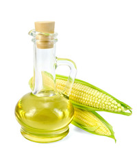 Corn oil in a carafe with two cobs