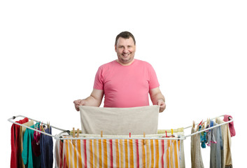Smiling fat man in red t-shirt drying washing