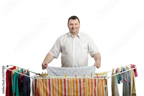 Smiling fat man in shirt drying laundry