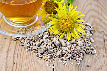 Herbal tea from the root of elecampane with cup and flower