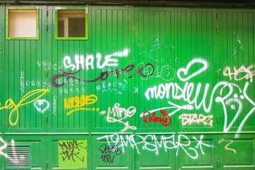 Graffiti on a green wooden wall
