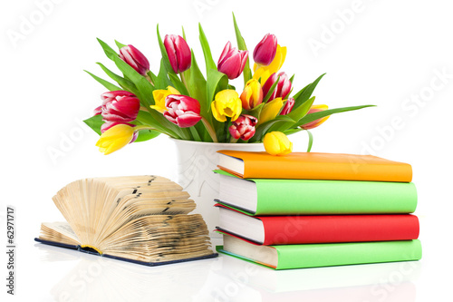 bunch of spring tulips and books, isolated on white background