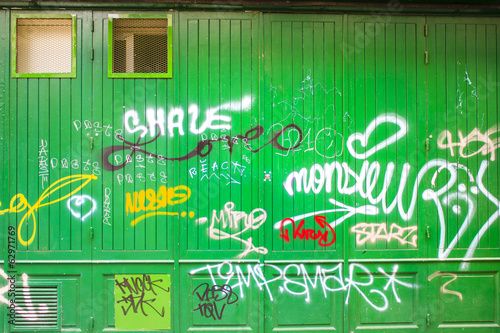 Graffiti on a green wooden wall
