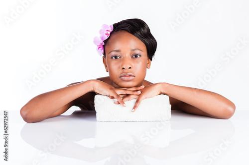 Beautiful African woman in Studio with towel