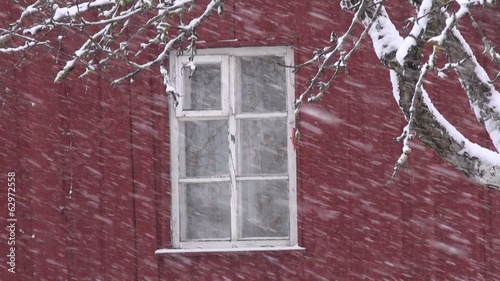 winter  snow falling on farm house window background