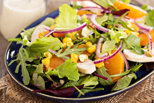 Salad with chicken, oranges and greens