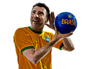 caucasian man brazilian brazil listening to soccer ball