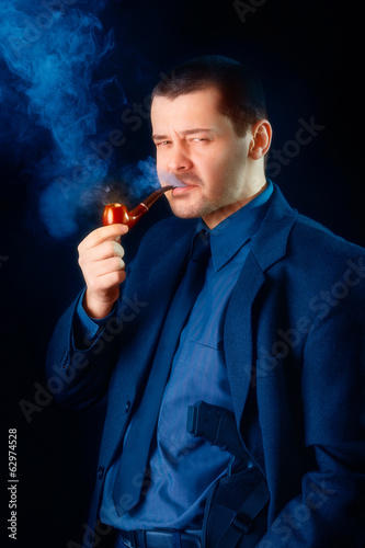 Man with Gun Holstered Smoking Pipe