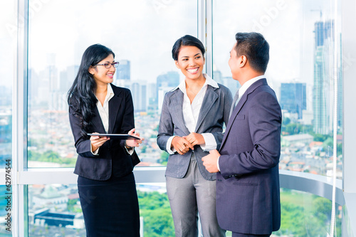Asian Businesspeople standing in office