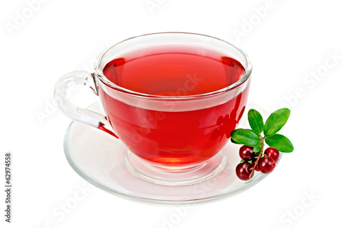 Tea with cranberries in a glass cup