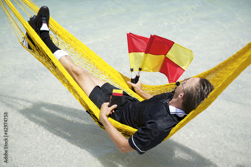 Soccer Football Referee Relaxing on Brazilian Beach