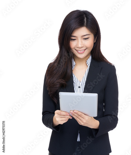 Asia businesswoman using tablet