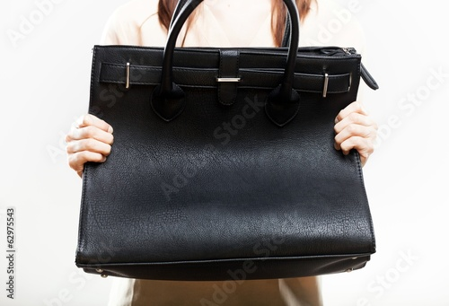 Elegant woman with her black bag closeup
