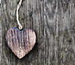 A wooden vintage heart on grunge wood planks. Symbol of love,