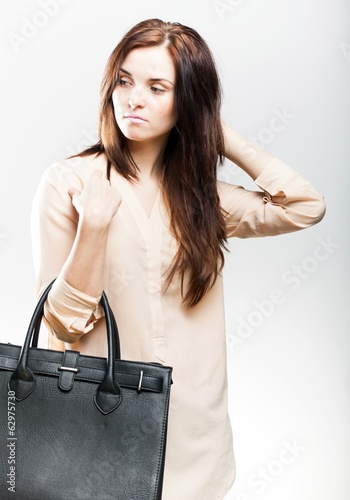 Elegant young woman with leather bag