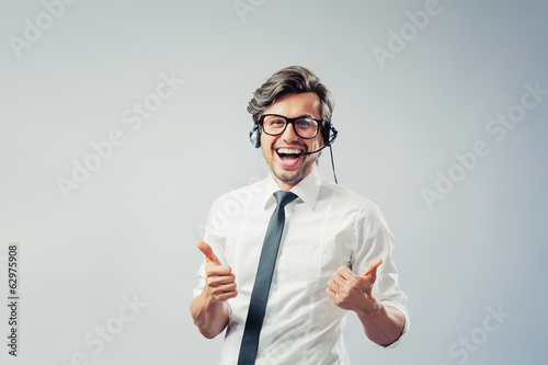 Businessman showing thumbs up and smiling
