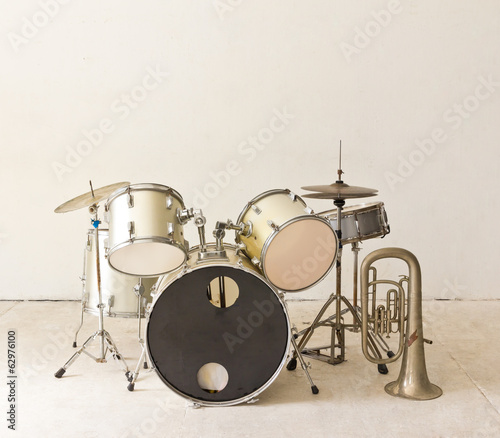 set of drums in white room