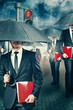 Businessmen with umbrella outdoors