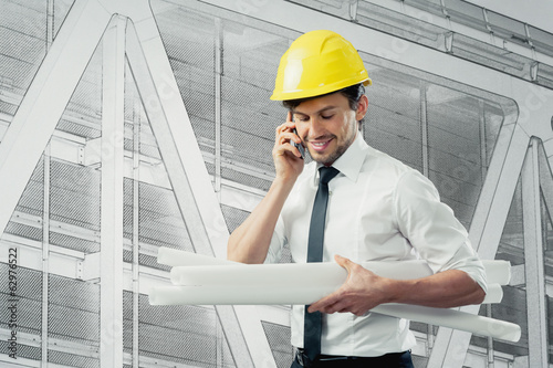 Architect with cellphone and plans