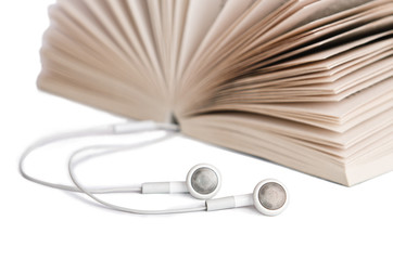 Concept of audio books with earphones on white