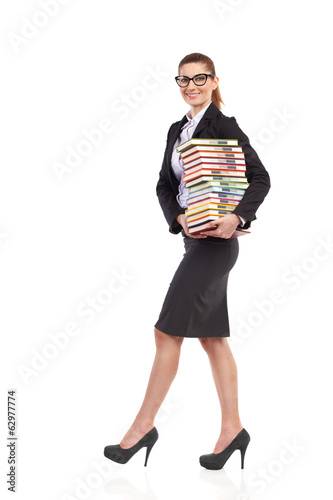 Cheerful teacher with books