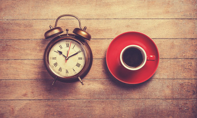Alarm clock and cup of a coffee