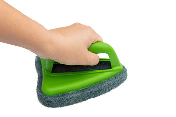 Hand holding and cleaning with brush scrubber isolated white bac