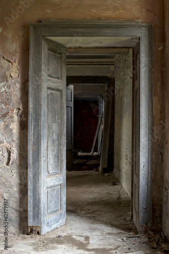 Doors against the wall in abandoned house