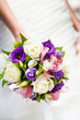 Wedding bouquet with different flowers in hands of bride