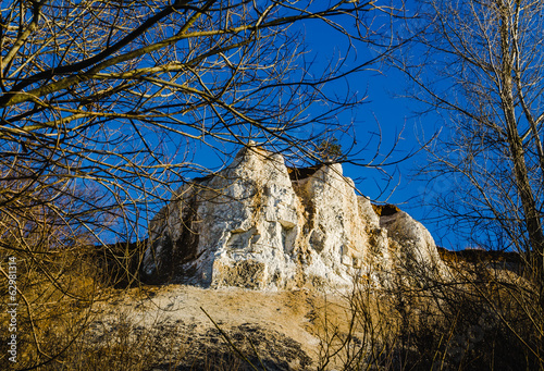 mountains rock view with blue sky. Trees around