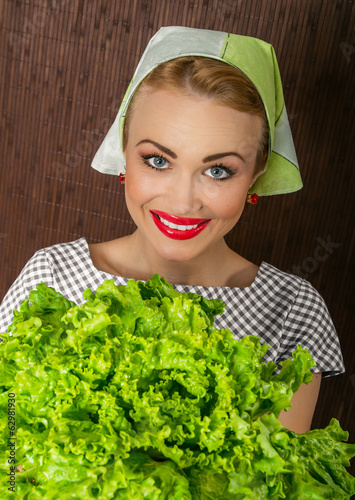 Happy smiling woman cook holding salad