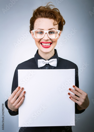 Cheerful young woman with blank white board
