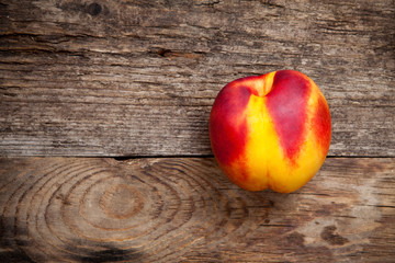 Fresh nectarine on wooden table