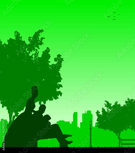 Wedding couple posturing in park silhouette