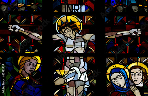 Crucified Christ and the Holy Chalice, in stained glass